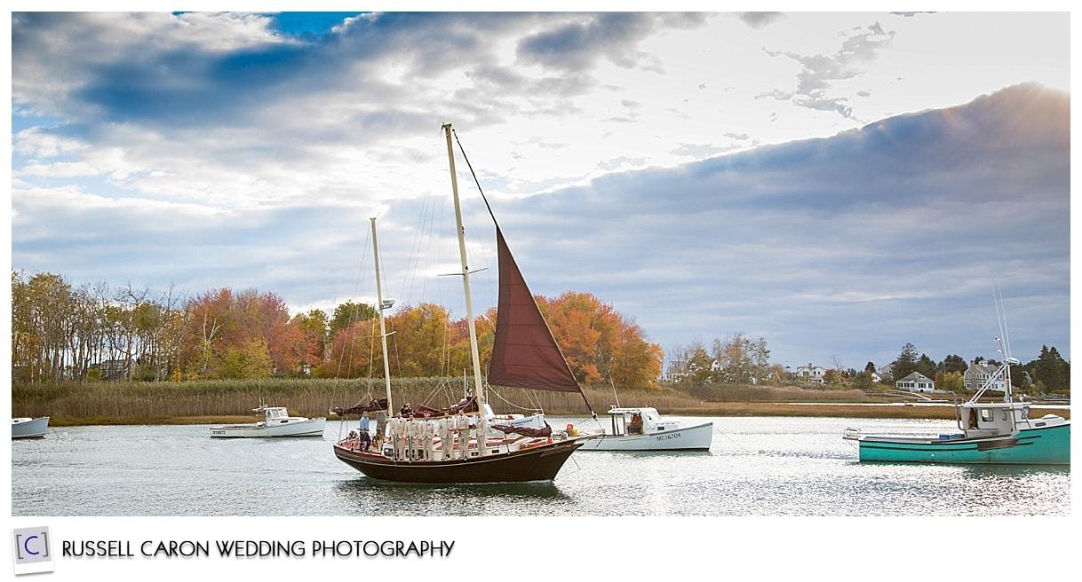 groom-and-groomsmen-sailing-kennebunk-river