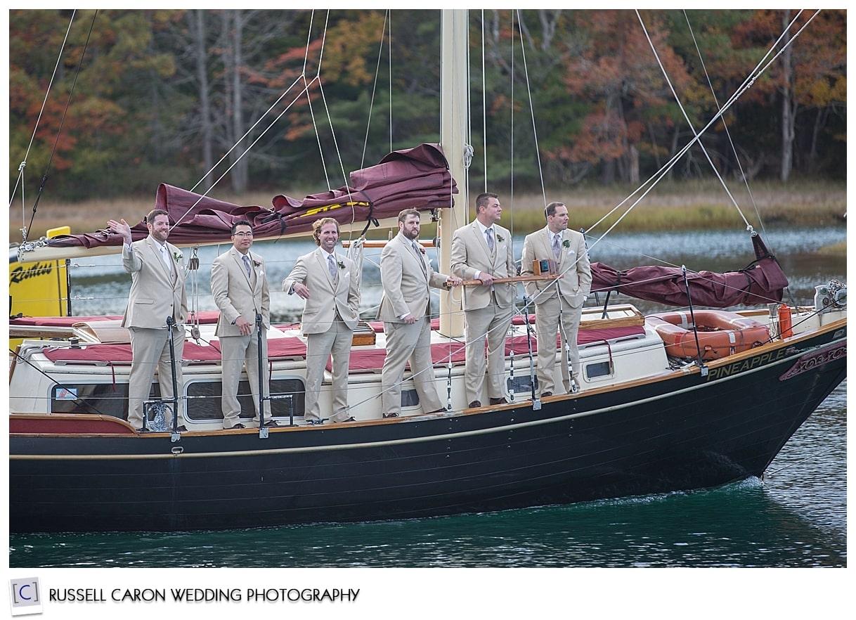groom-and-groomsmen-on-sailboat