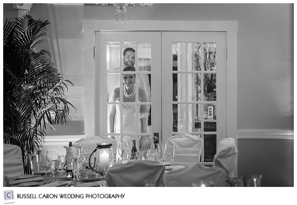 bride-and-groom-peeking-in-nonantum-resort-wedding-reception