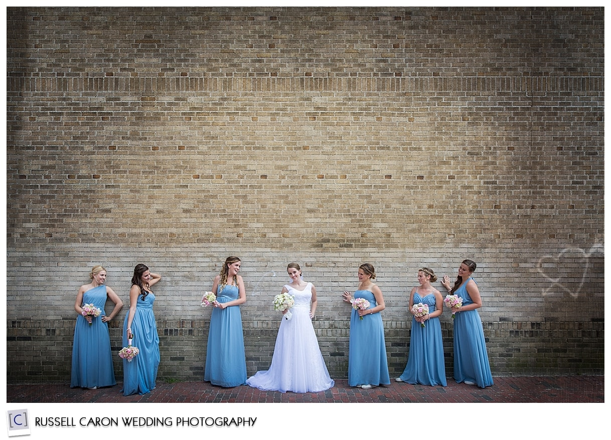 Bride and bridesmaids in front of wall, #46, 50 best wedding images of 2015