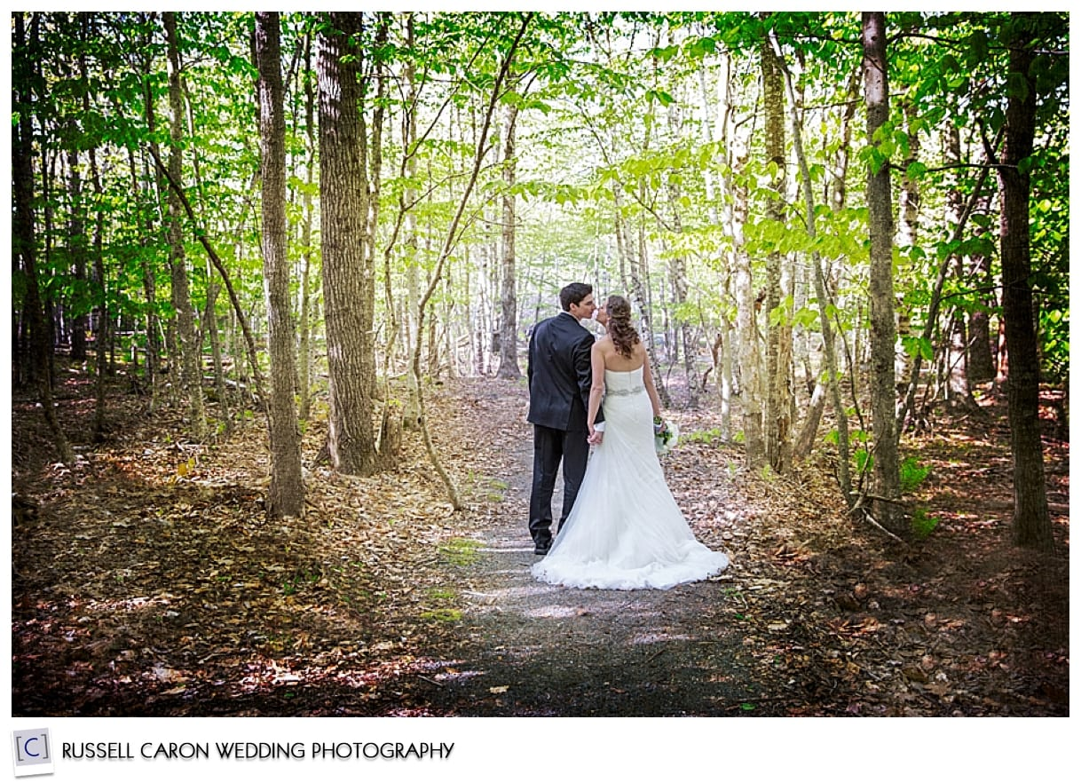 Bride and groom kissing in the woods, Bar Harbor, Maine