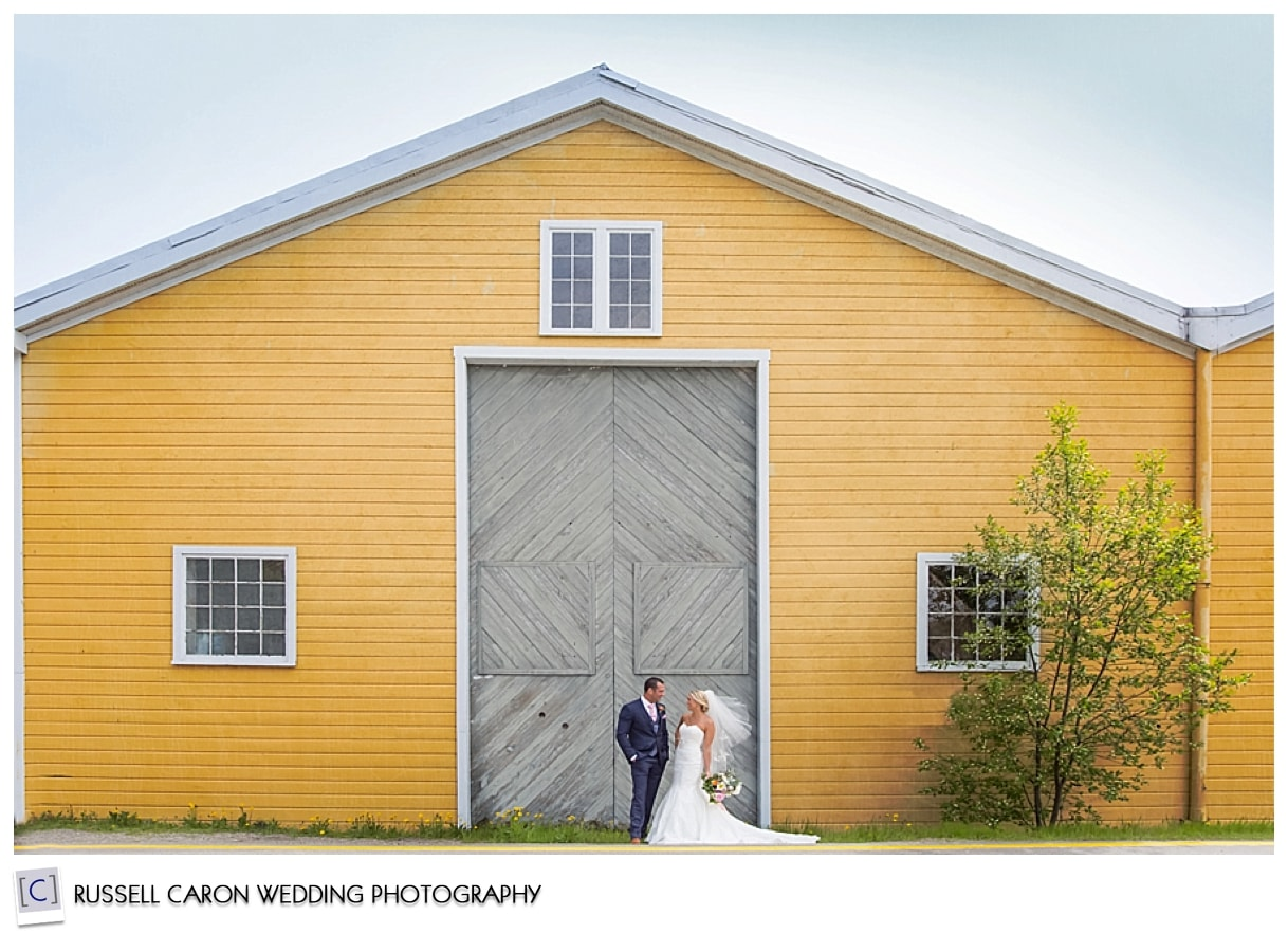 Beautiful bride and groom in front of barn, Boothbay Harbor, Maine weddings