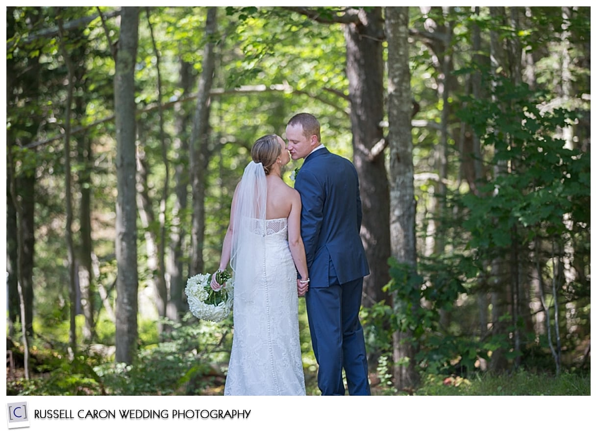 Bride and groom kissing in the woods, Phippsburg, Maine weddings