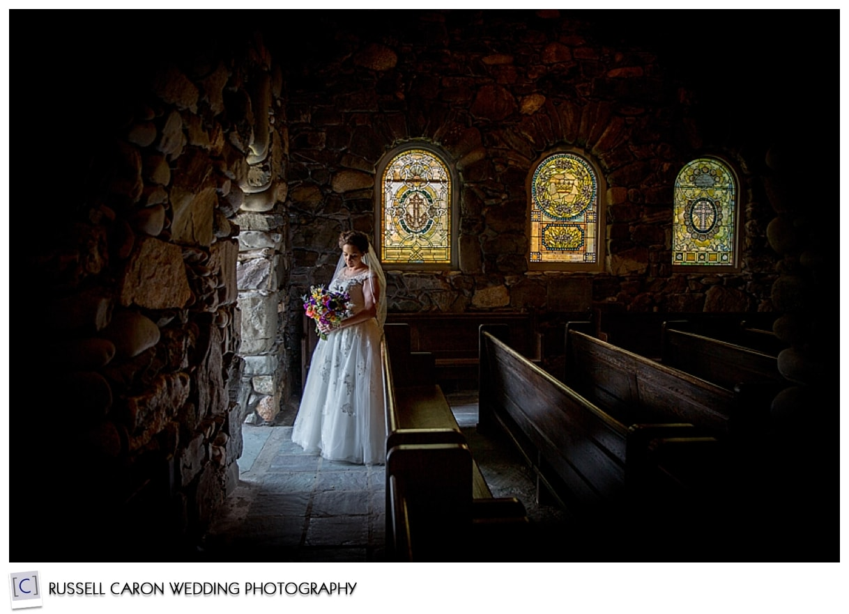 Bride standing in beam of light at St. Ann's Episcopal Church