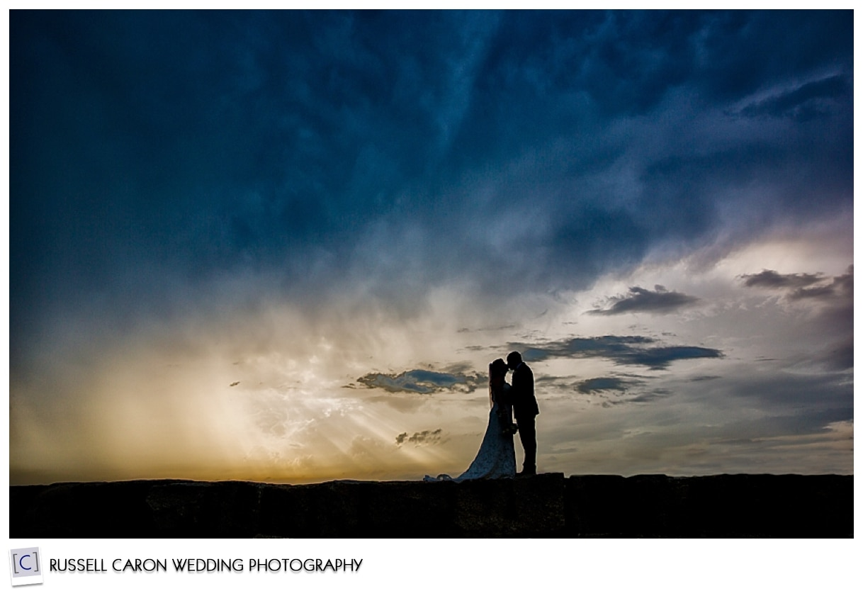 Bride and groom embrace on Kennebunkport breakwater, #3, 50 best wedding images of 2015