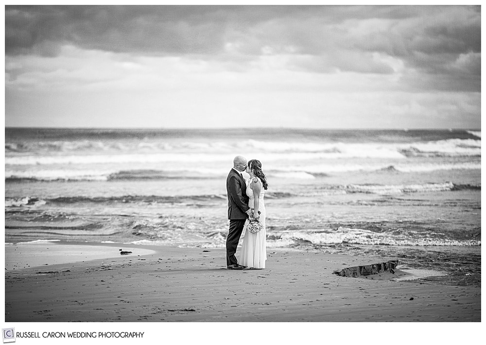 wedding couple in a romantic black and white  image at the ocean