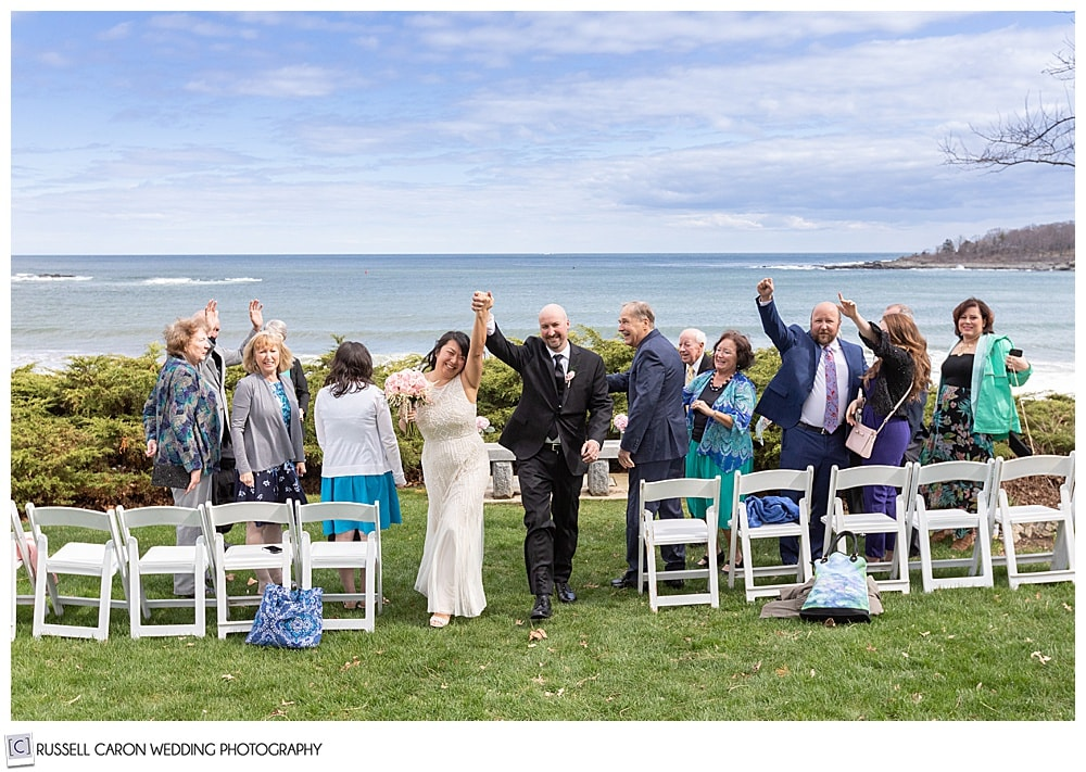 couple just married recessional from outdoor wedding