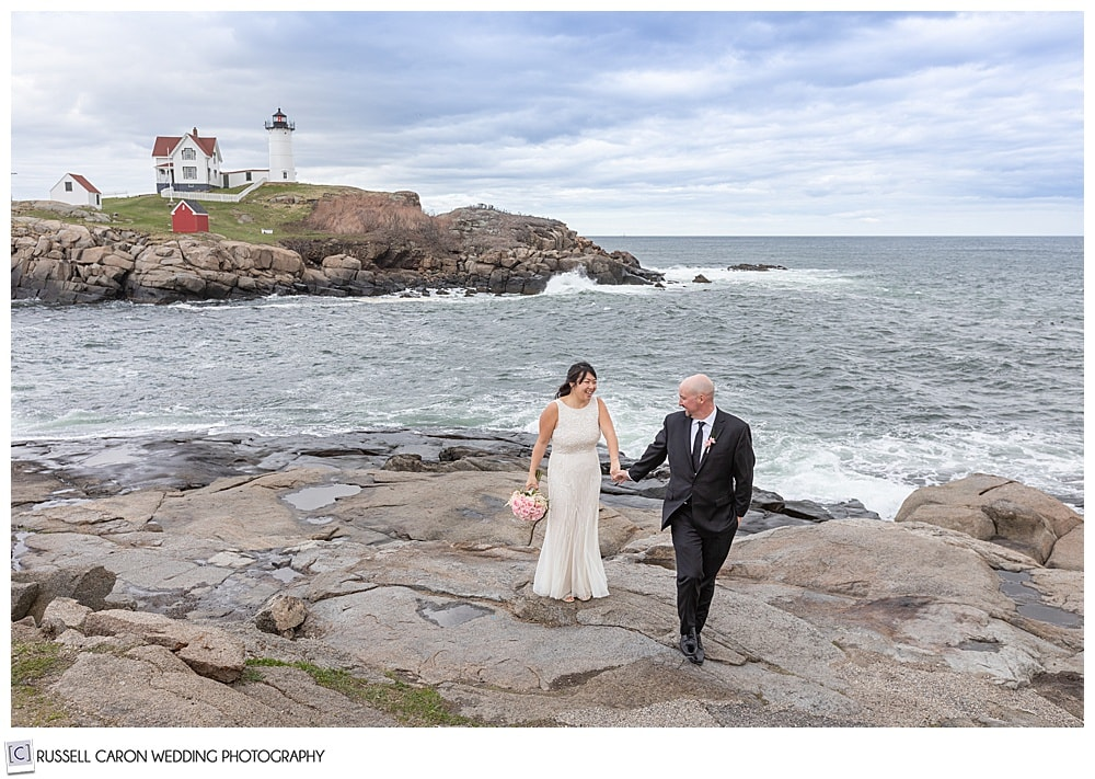 just married couple at nubble light in york maine