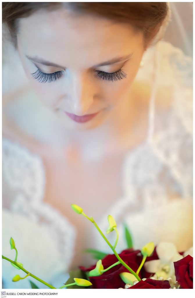 Gorgeous bridal portrait of a bride looking down at her bouquet