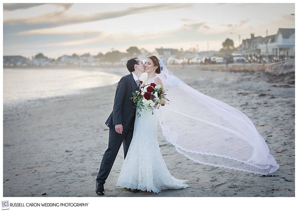 stunning beach moment with a bride and groom on Gooch's Beach in Kennebunk, Maine