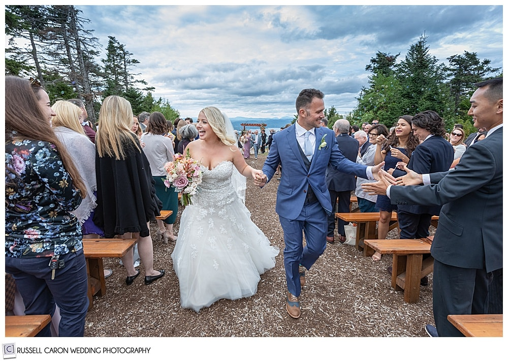 overjoyed wedding recessional image of a bride and groom at Mount Sunapee