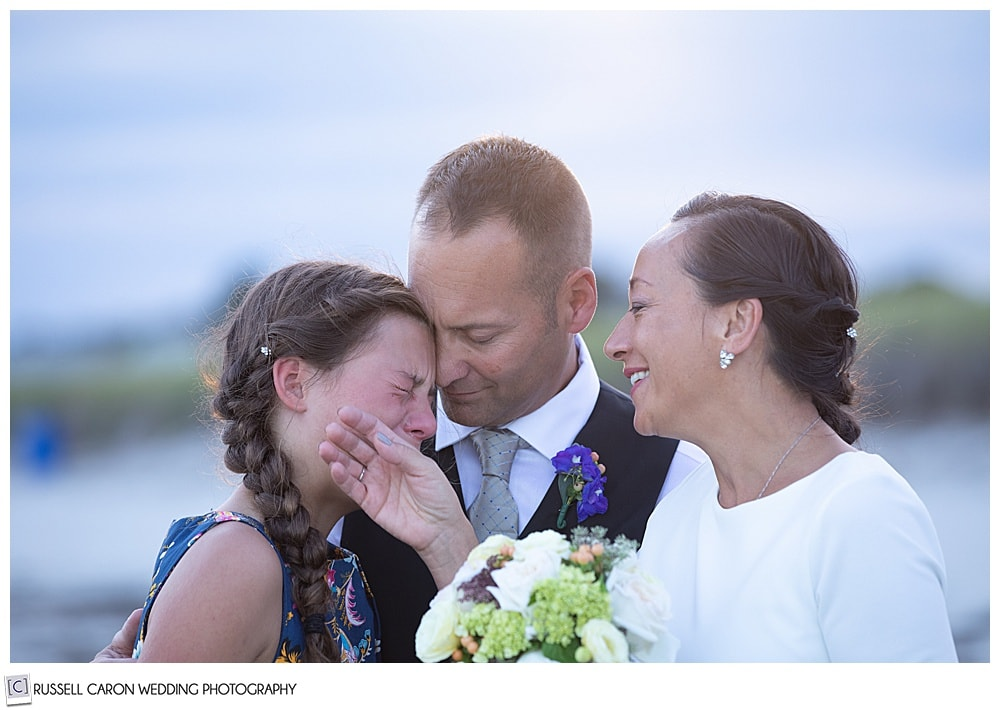 poignant family wedding moment of father, daughter and mother