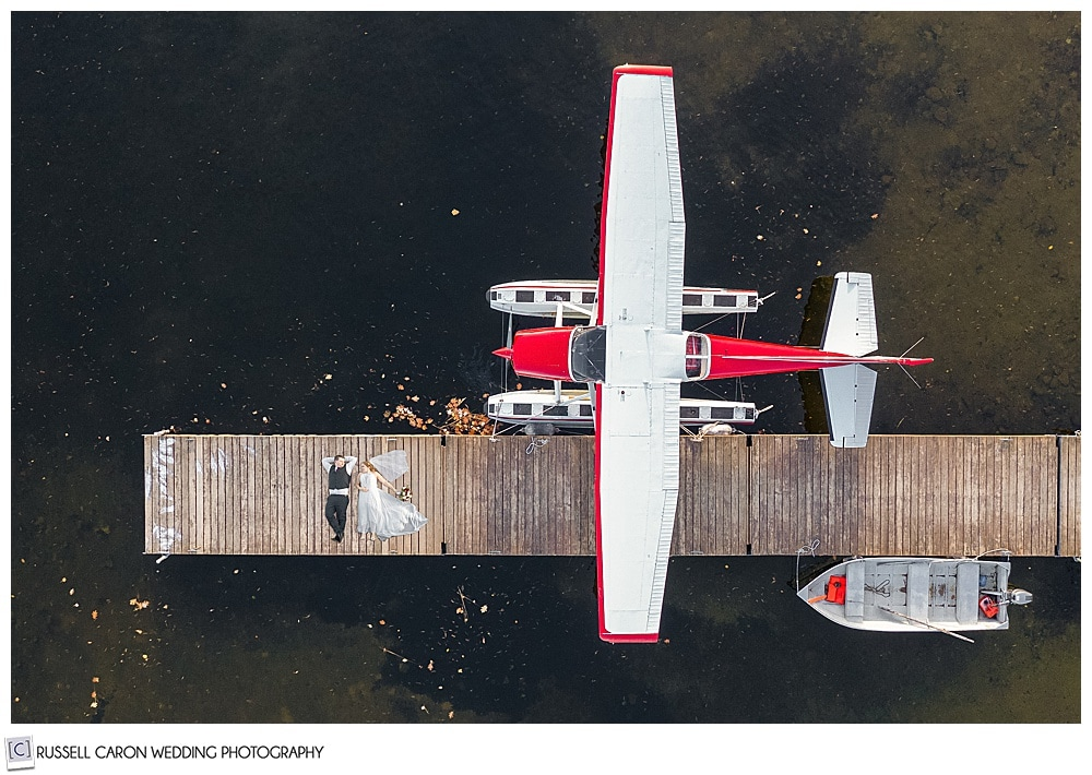 Bride and groom in seaplane drone photo at a lakeside Maine wedding, Naples, Maine