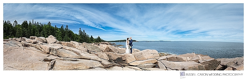 Bride and groom standing on the pink granite of Acadia National Park, Bar Harbor, Maine