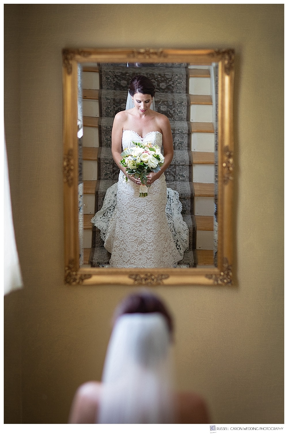 bridal portrait reflected in mirror at the Atlantic Oceanside, Bar Harbor, Maine