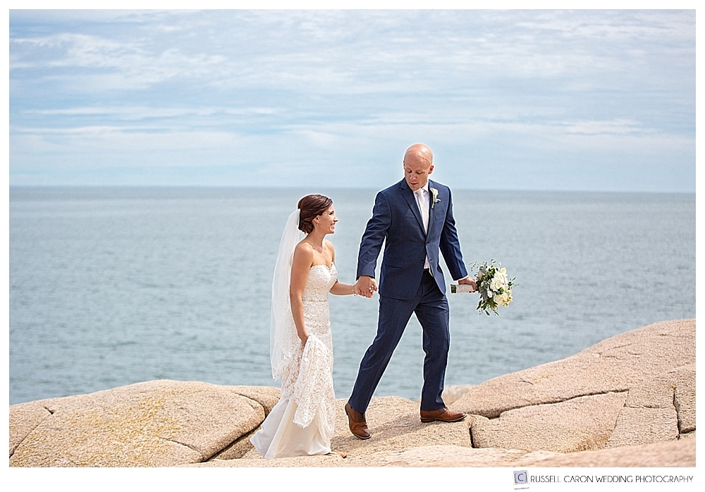 Bride and groom walking on the pink granite at Acadia National Park, Bar Harbor, maine