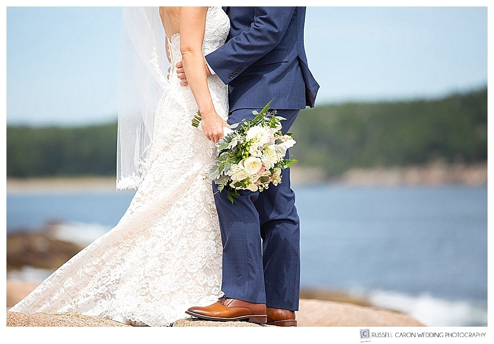 bride and groom standing together, with bride's bouquet from Cottage Flowers, in Acadia National Park, Bar Harbor, Maine