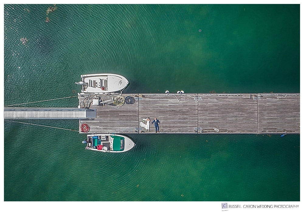 Maine drone wedding photographers take photo of bride and groom on the dock at the Atlantic Oceanside Resort, Bar Harbor, Maine