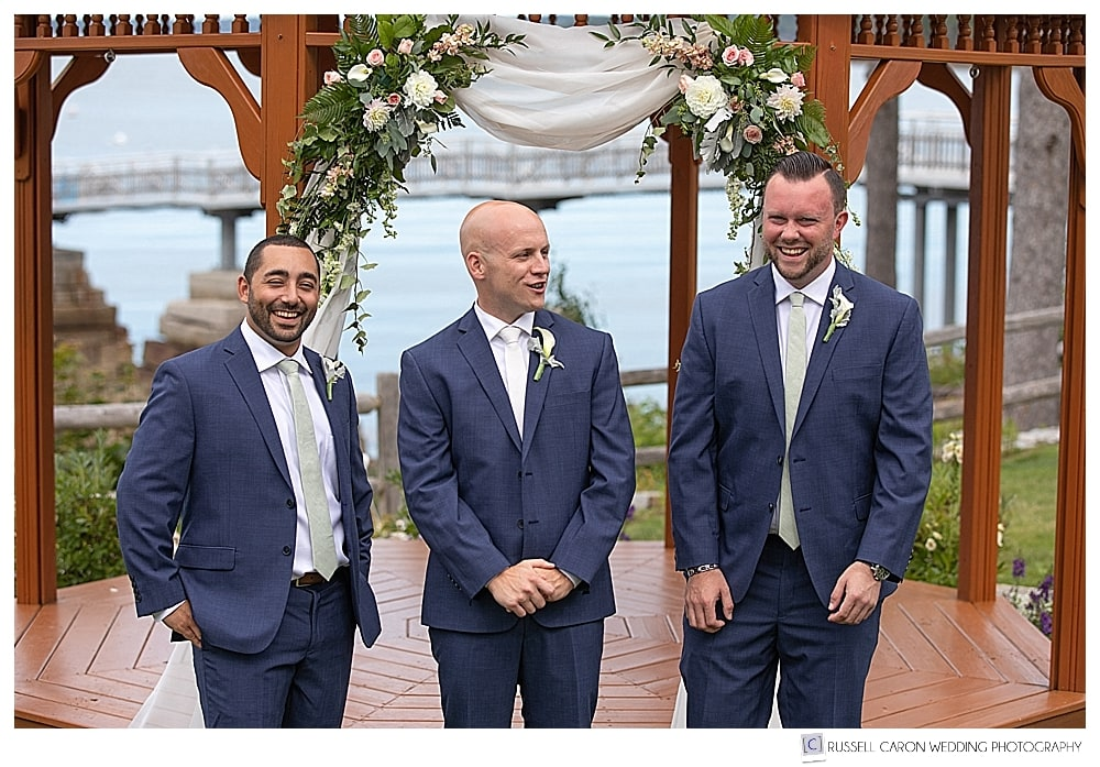 groom and groomsmen laughing together in front of the gazebo at the Atlantic Oceanside Resort, Bar Harbor, Maine