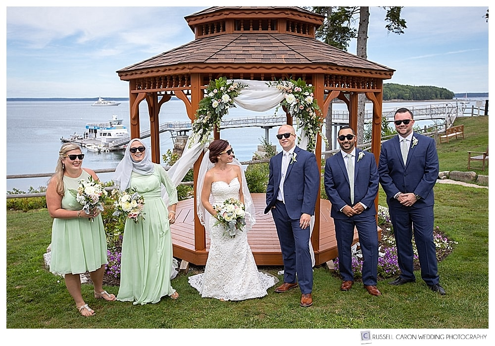 bridal party wearing sunglasses in front of the gazebo at the Atlantic Oceanside Resort, Bar Harbor, Maine