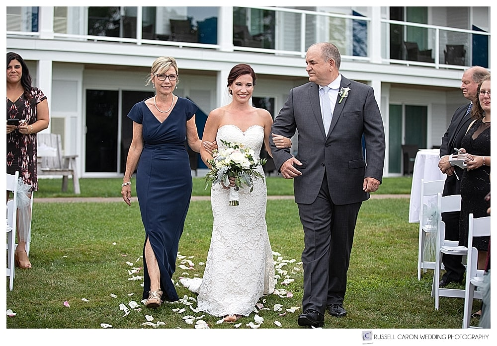 bride walking down the aisle with her parents, at her Atlantic Oceanside Bar Harbor wedding, Bar Harbor, Maine