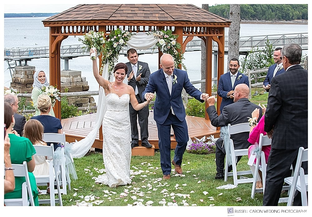 bride and groom during the recessional, during their Atlantic Oceanside Bar Harbor wedding, Bar Harbor, Maine