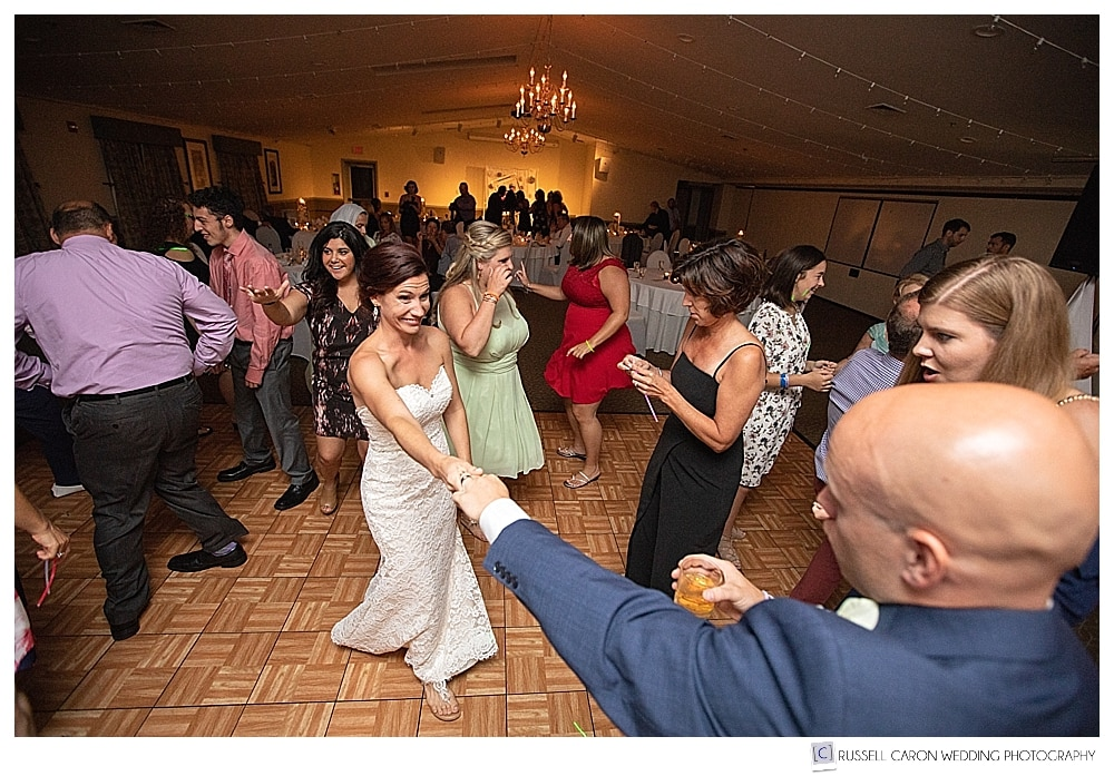 bride and groom having fun during their wedding reception