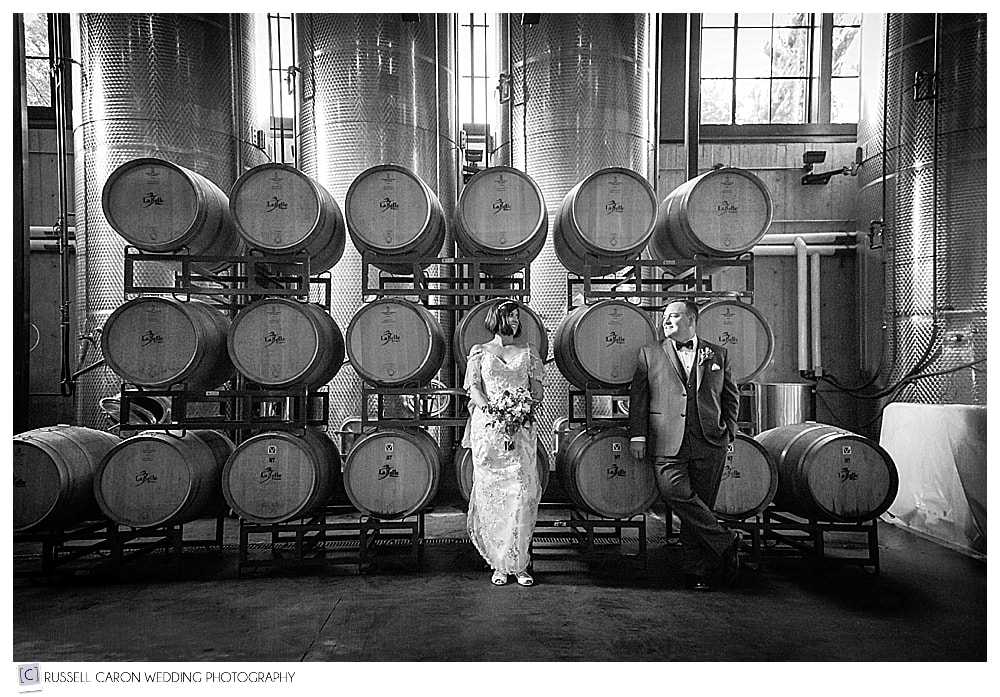 A stellar wedding image of Amy and Jim surrounded by the wine casks at LaBelle Winery, Amherst, NH