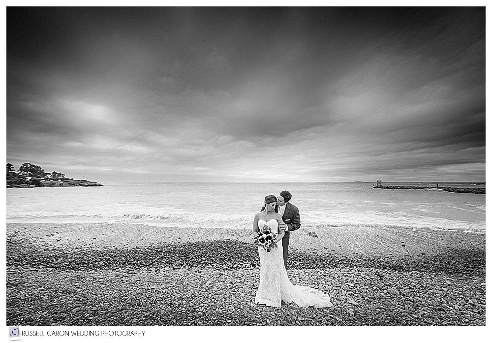 One of our dramatic environmental portraits of Laura and Ben at the Kennebunkport Breakwater, Kennebunkport, Maine wedding photographers. Our #12 best Maine wedding photos 2017