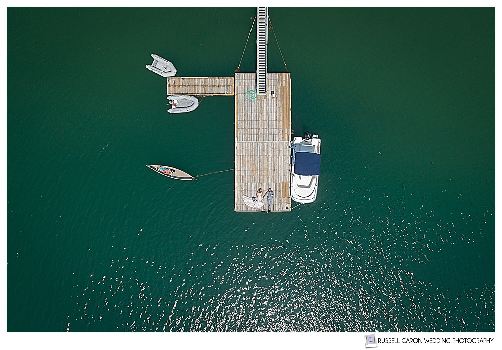 A bride and groom on a dock in a Bar Harbor Maine Drone wedding photo