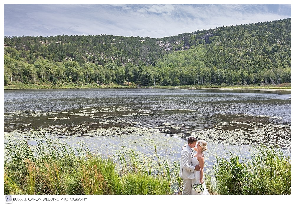 bride and groom near pond in bar harbor maine