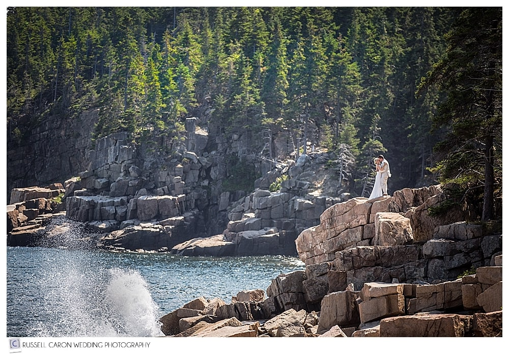 bride and groom on pink granite in acadia national park bar harbor maine