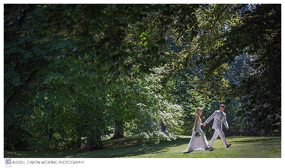 bride and groom walking near the Turrets at College of the Atlantic Bar Harbor
