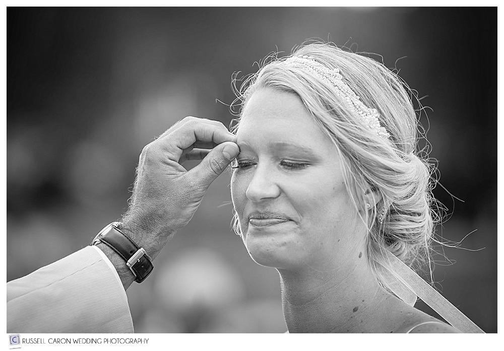 groom touches brides face