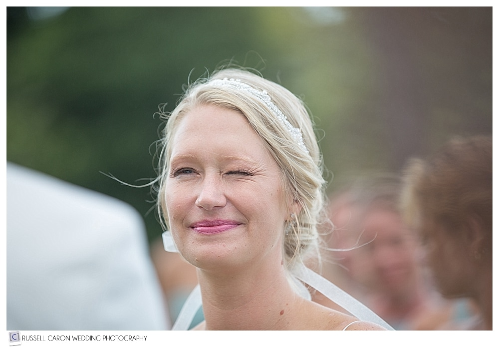 bride winking at groom during ceremony