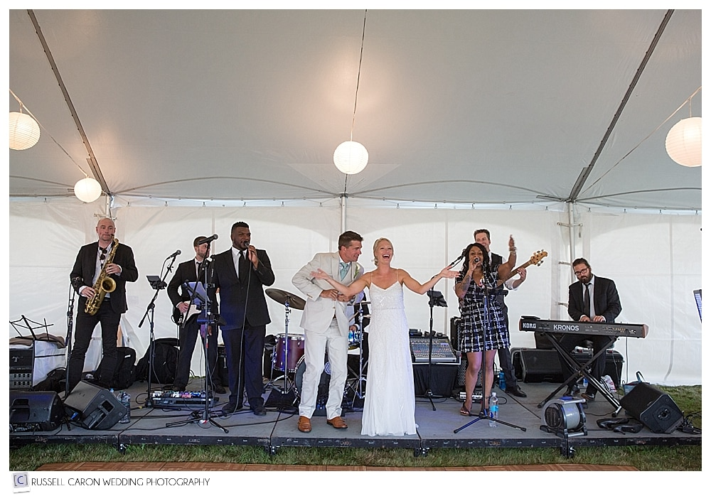 bride and groom onstage with ripcord band from boston