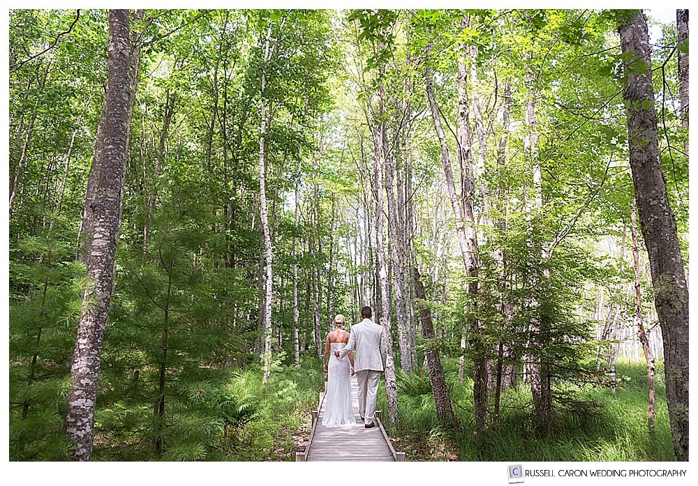 bride and groom walking on a trail in Acadia National Park, moments before their Bar Harbor Maine wedding