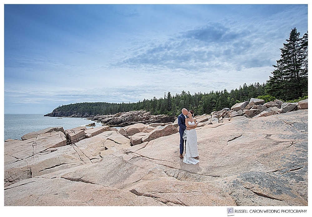 Bride and groom on the pink granite during their beautiful Acadia National Park wedding