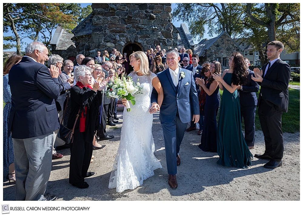 bride and groom during their recessional at their Saint Ann's Episcopal Church wedding, Kennebunkport, Maine