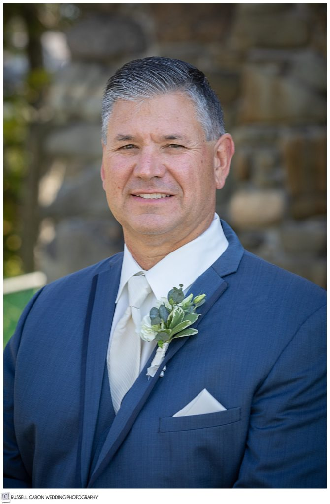 groom portrait of a man wearing a blue suite