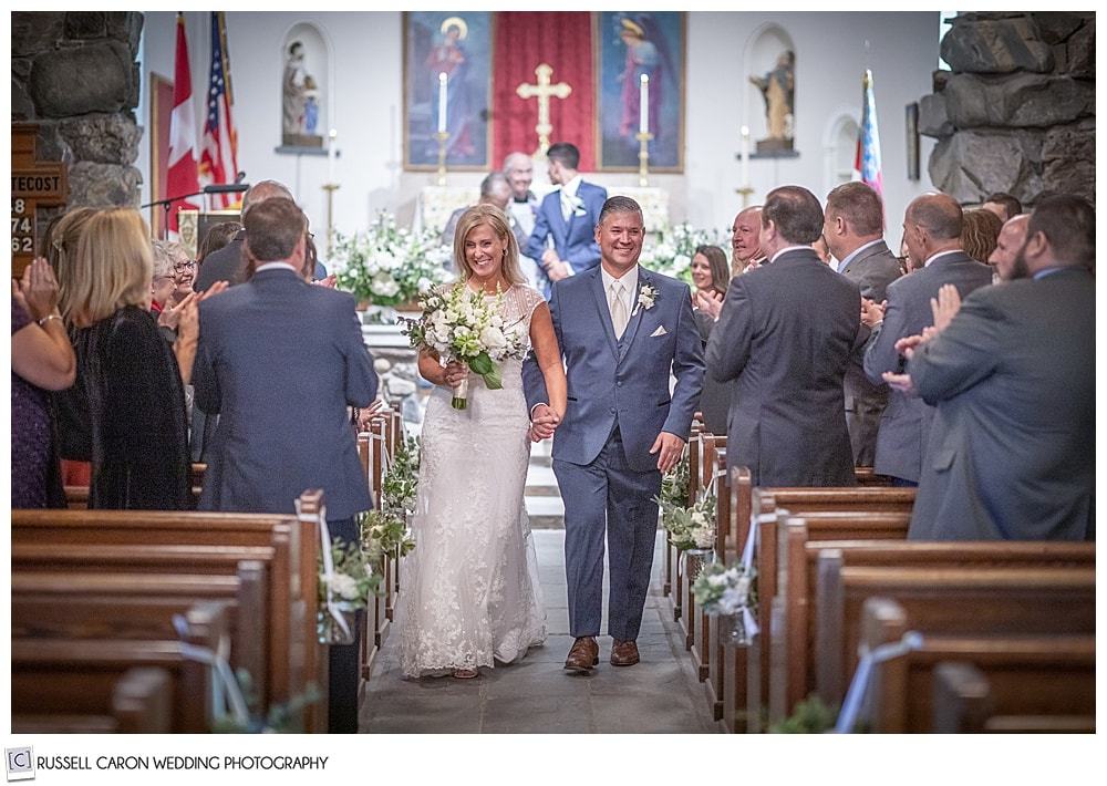 bride and groom during their wedding recessional at Saint Ann's Episcopal Church, Kennebunkport, Maine