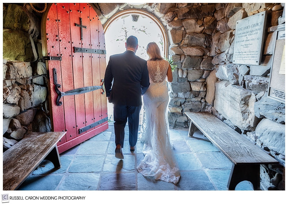 bride and groom exiting Saint Ann's Episcopal Church during their wedding ceremony in Kennebunkport, Maine