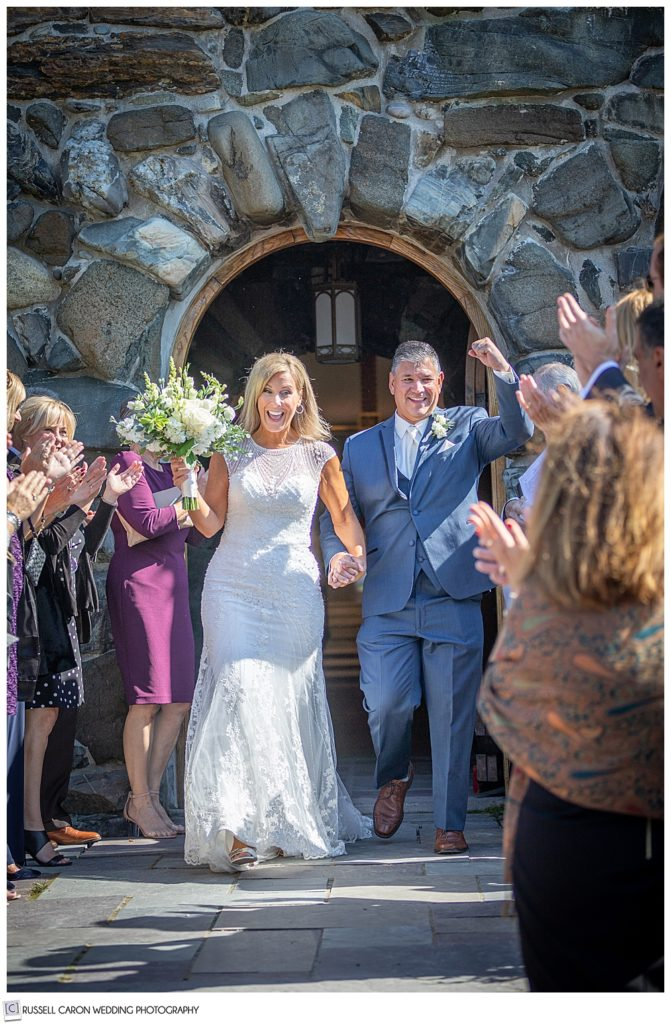 bride and groom coming out of Saint Ann's Episcopal Church during their Kennebunkport, Maine, wedding recessional
