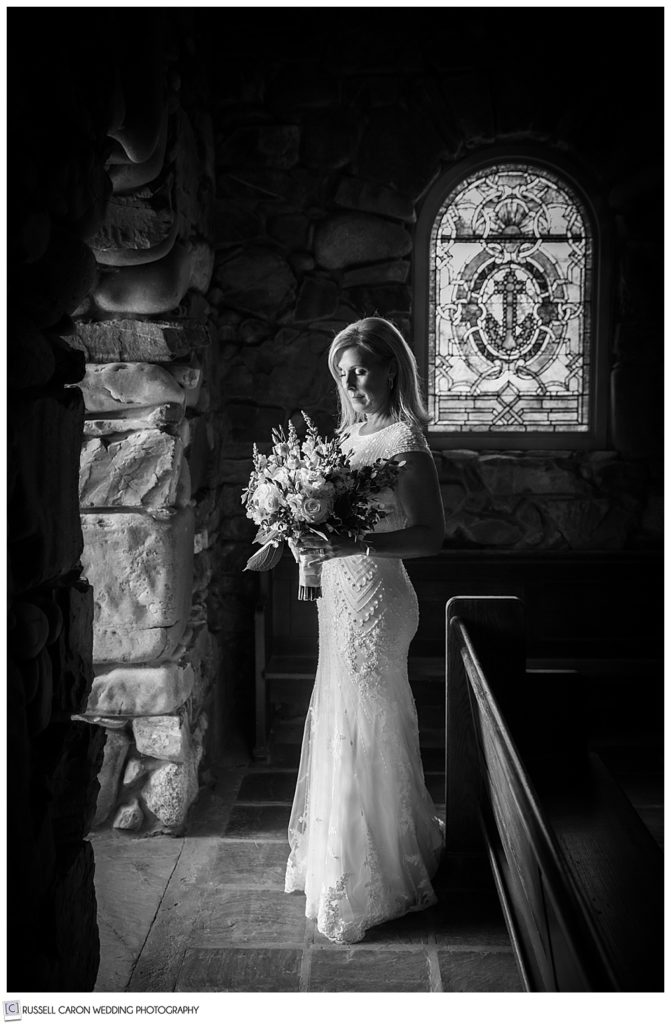 black and white photo of a bride standing in the doorway of Saint Ann's Episcopal Church in Kennebunkport, Maine