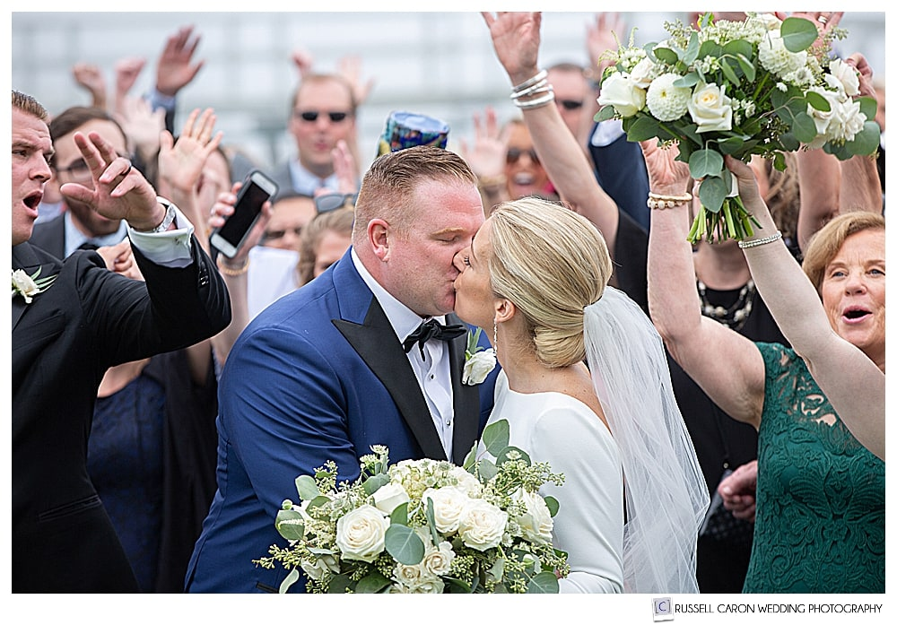 bride and groom have a celebratory wedding kiss at their Newagen Seaside Inn wedding