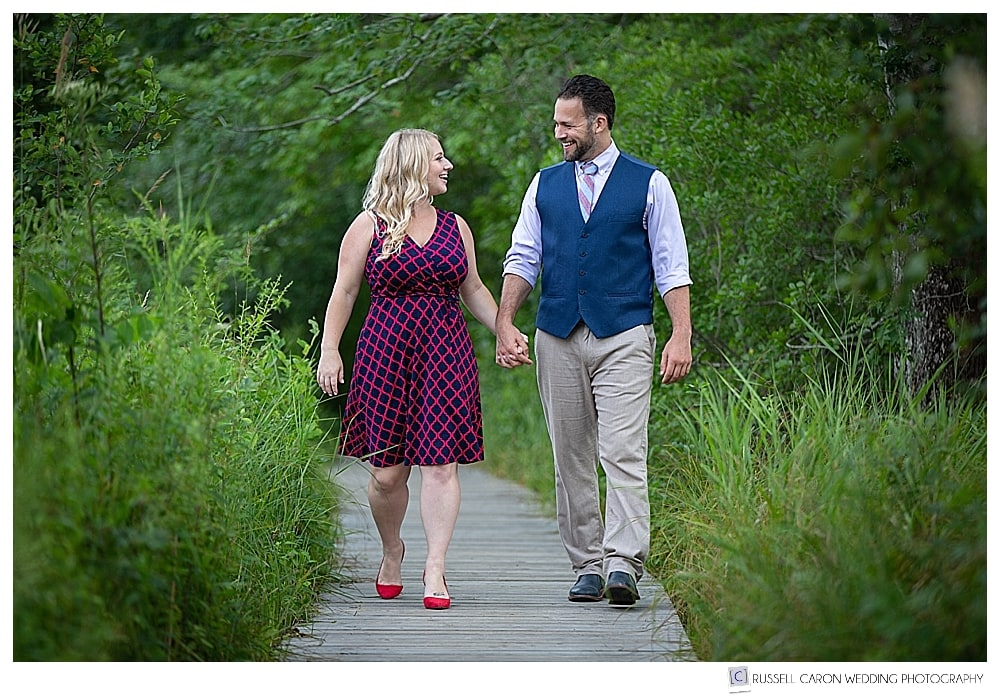 mand and woman walking on boardwalk in the woods, holding hands, Inn by the Sea, Cape Elizabeth, Maine