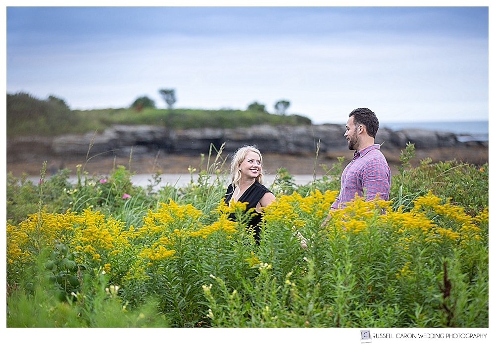 man and woman walking among the wildflowers, at Kettle Cove, Cape Elizabeth, Maine