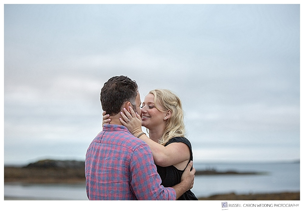 man and woman standing together at Kettle Cove, Cape Elizabeth, Maine engagement photo session