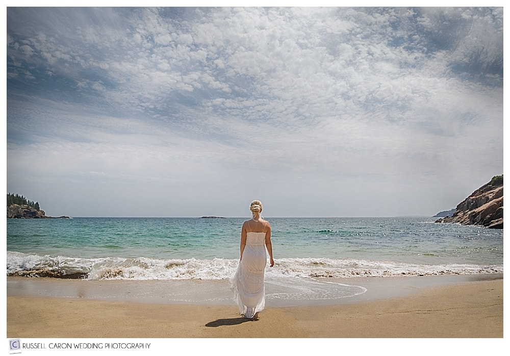 Meredith walking towards the water at Sand Beach is one of our dreamy wedding images