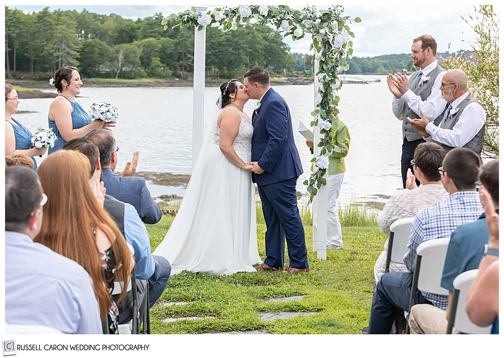 bride and groom's first kiss at their Edgecomb Maine wedding